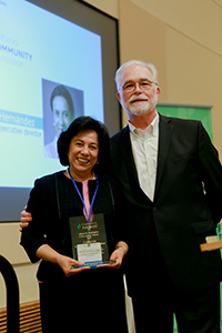 California Community Foundation's CEO Antonia Hernandez poses with her Civic Legacy plaque and with Community Partners' CEO Paul Vandeventer